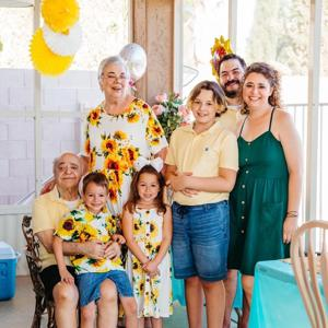 Caregiver with her family at a birthday party
