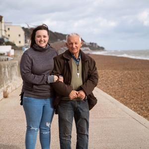 Caregiver with her dad outside near the beach