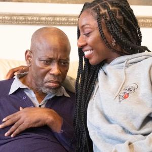 Caregiver smiling with her father
