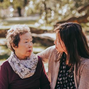 Caregiver hugging her mother outside