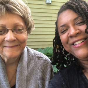 Caregiver taking a smiling selfie with her mother