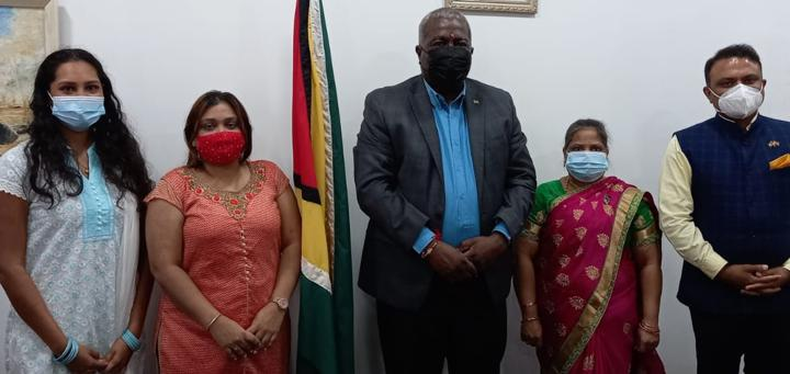Female members of the Indian High Commission in Guyana pose for a picture with Prime Minister Mark Phillips and High Commissioner Dr. K.J. Srinivasa.