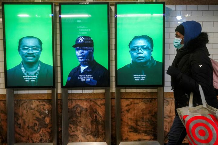 Monitors display deceased MTA workers as a tribute at Fulton St subway station amid the coronavirus disease (COVID-19) pandemic in the Manhattan borough of New York City, New York, U.S., February 3, 2021. REUTERS/Carlo Allegri
