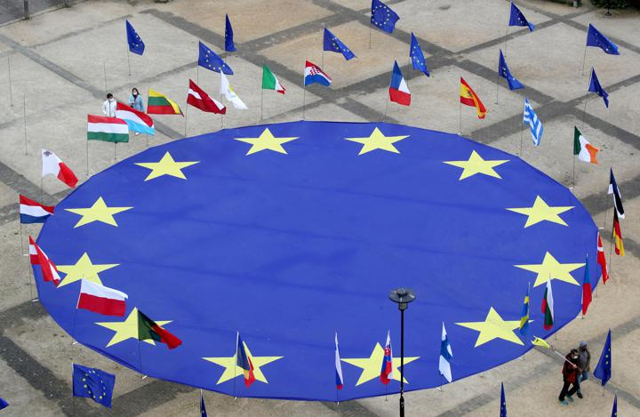 A large European Union flag lies at the centre of Schuman square, outside the European Commission headquarters. [Reuters]