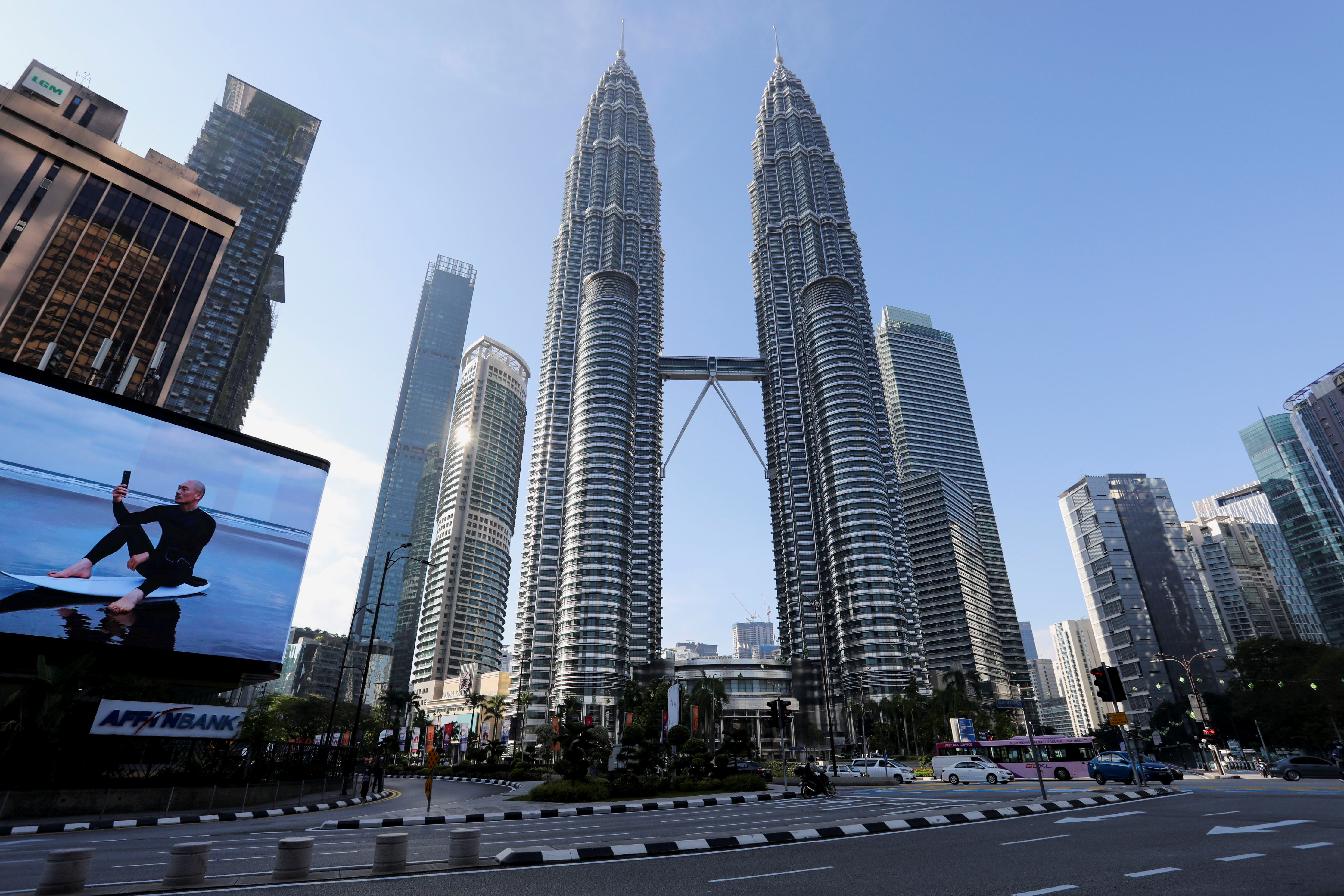 Empty streets and malls as Malaysia locks down