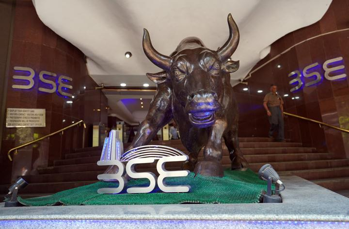 FILE PHOTO: A man walks out of the Bombay Stock Exchange (BSE) building in Mumbai, India, February 28, 2020. REUTERS/Hemanshi Kamani/File photo