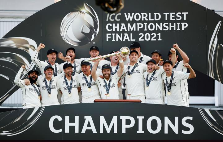 FILE PHOTO: Cricket - ICC World Test Championship Final - India v New Zealand - Rose Bowl, Southampton, Britain - June 23, 2021 New Zealand's Kane Williamson celebrates with the trophy and teammates after winning the final to because the ICC World Test Champions Action Images via Reuters/John SibleyFILE PHOTO: Cricket - ICC World Test Championship Final - India v New Zealand - Rose Bowl, Southampton, Britain - June 23, 2021 New Zealand's Kane Williamson celebrates with the trophy and teammates after winning the final to because the ICC World Test Champions Action Images via Reuters/John Sibley