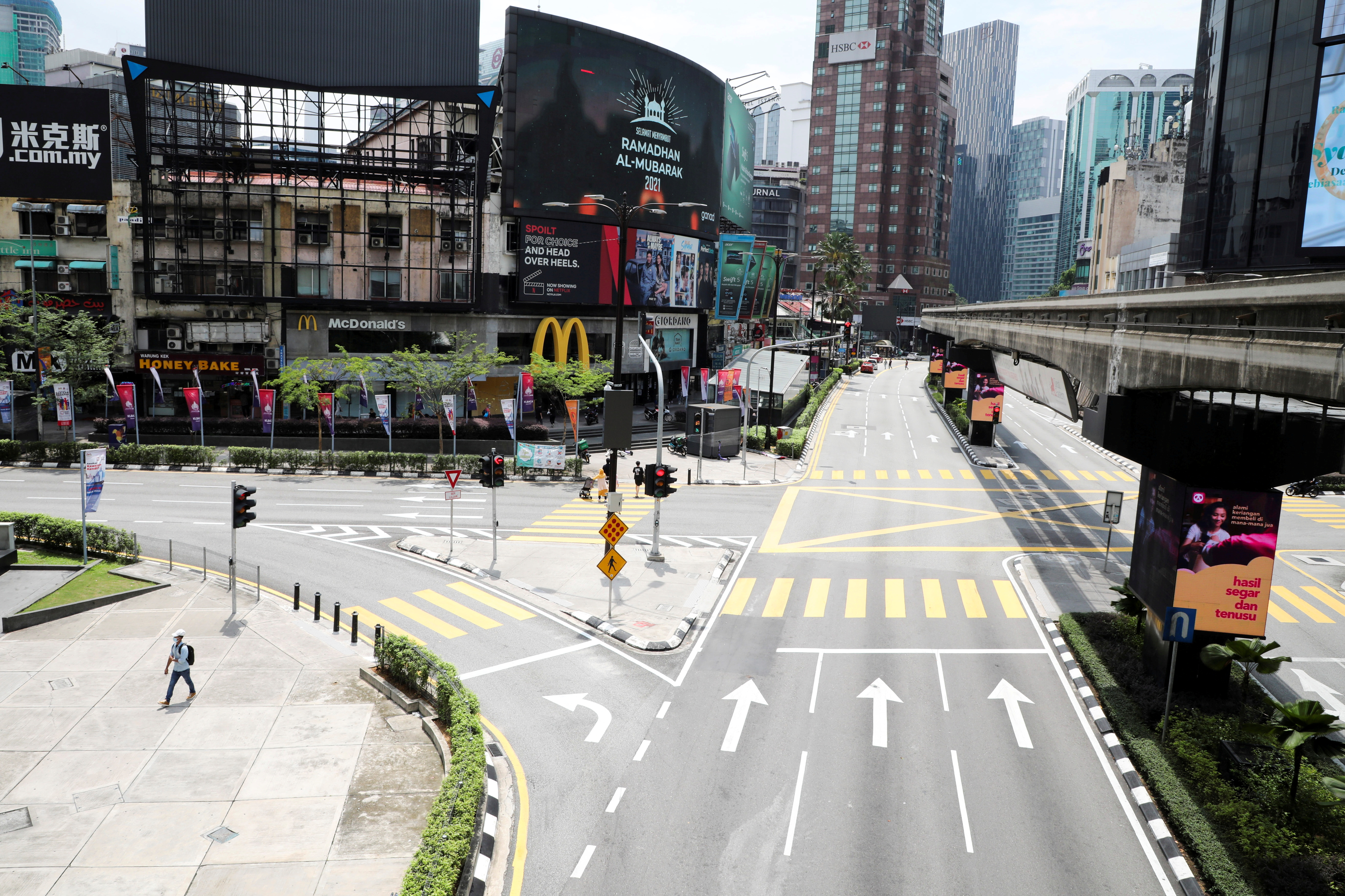 Kuala Lumpur imposes tighter restrictions to curb the spread of C