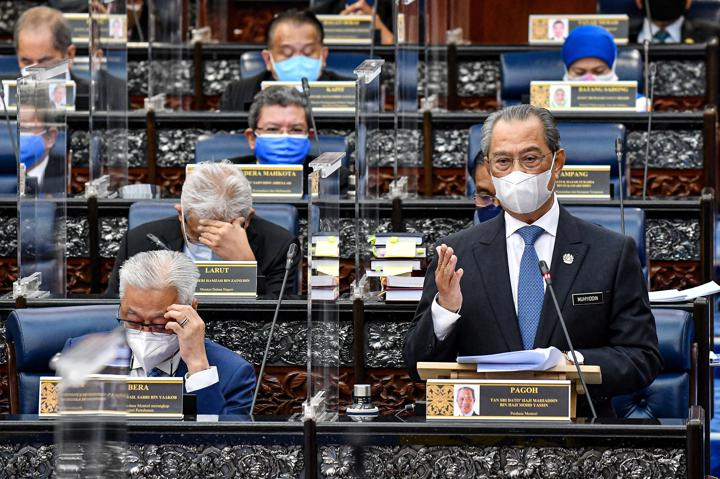 FILE PHOTO: Malaysia's Prime Minister Muhyiddin Yassin speaks during a session of the lower house of parliament, in Kuala Lumpur, Malaysia July 26, 2021. Malaysia Information Department/Famer Roheni/Handout via Reuters/Files