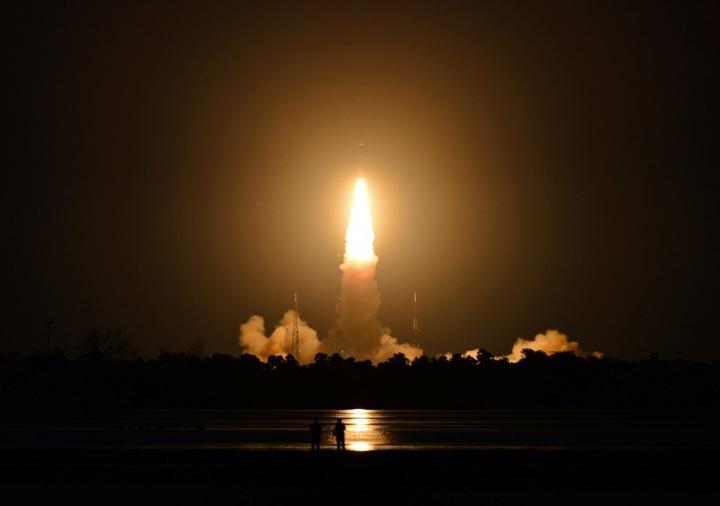 People watch as India's Geosynchronous Satellite Launch Vehicle (GSLV-F10), carrying the earth observation satellite EOS-03, lifts off from the Satish Dhawan Space Centre in Sriharikota, India, August 12, 2021. REUTERS/Stringer