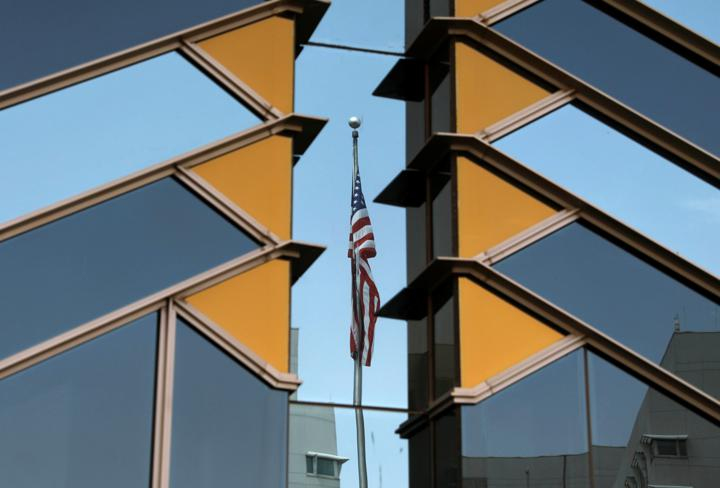 FILE PHOTO: The U.S. flag is reflected on the windows of the U.S. Embassy in Kabul, Afghanistan July 30, 2021. REUTERS/Stringer