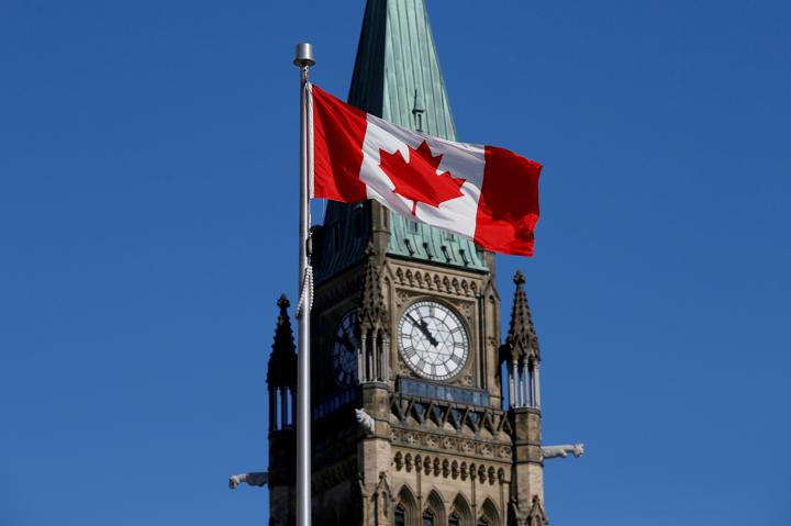 FILE PHOTO: A Canadian flag flies in front of the Peace Tower on Parliament Hill in Ottawa, Ontario, Canada, March 22, 2017. REUTERS/Chris Wattie