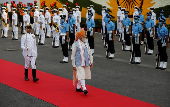 Indian Prime Minister Narendra Modi inspects the honour guard during Independence Day celebrations at the historic Red Fort in Delhi, India, August 15, 2021. REUTERS/Adnan Abidi