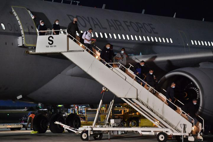 British nationals and Afghan evacuees arrive on a flight from Afghanistan at RAF Brize Norton, Britain August 17, 2021. Picture taken August 17, 2021. Mark Large/Pool via REUTERS