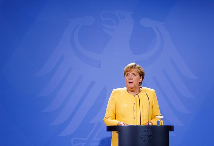 FILE PHOTO: German Chancellor Angela Merkel speaks during a news conference on the current developments in Afghanistan, at the Chancellery in Berlin, Germany August 16, 2021 Odd Andersen/Pool via REUTERS