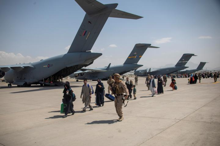Members of the UK Armed Forces continue to take part in the evacuation of entitled personnel from Kabul airport, in Kabul, Afghanistan August 19-22, 2021, in this handout picture obtained by Reuters on August 23, 2021. LPhot Ben Shread/UK MOD Crown copyright 2021/Handout via REUTERS