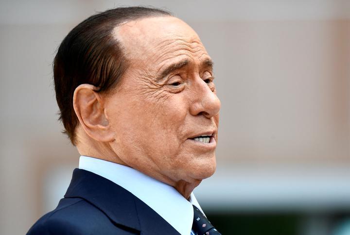 FILE PHOTO: Former Italian Prime Minister Silvio Berlusconi speaks to the media as he leaves San Raffaele hospital in Milan, Italy, September 14, 2020. REUTERS/Flavio Lo Scalzo/File Photo