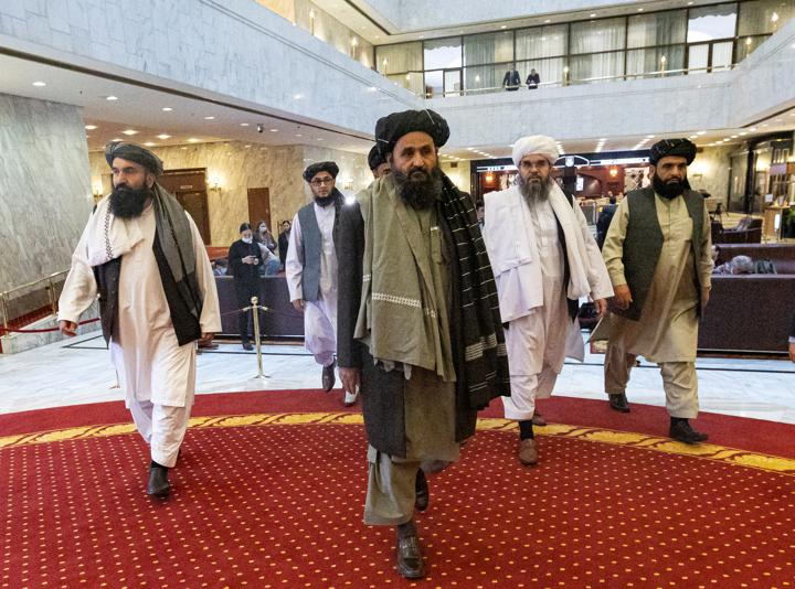 FILE PHOTO: Mullah Abdul Ghani Baradar, the Taliban's deputy leader and negotiator, and other delegation members attend the Afghan peace conference in Moscow, Russia March 18, 2021. Alexander Zemlianichenko/Pool via REUTERS