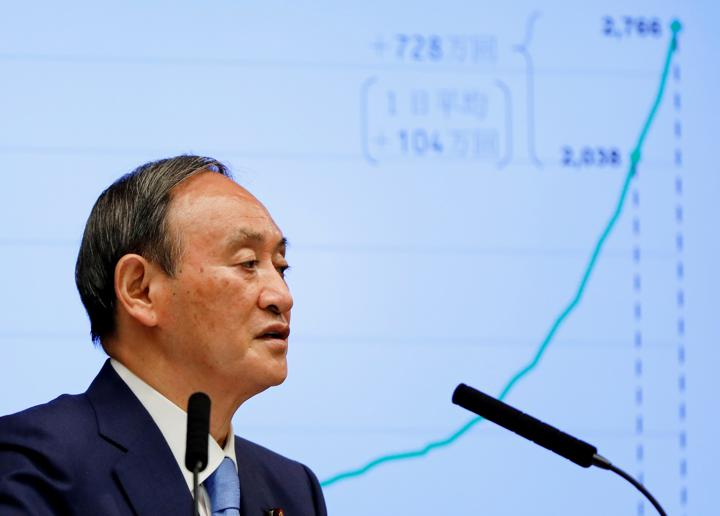 FILE PHOTO: Japanese Prime Minister Yoshihide Suga attends a news conference on Japan's response to the coronavirus disease (COVID-19) outbreak, at his official residence in Tokyo, Japan, June 17, 2021. REUTERS/Issei Kato/Pool/File Photo/File Photo