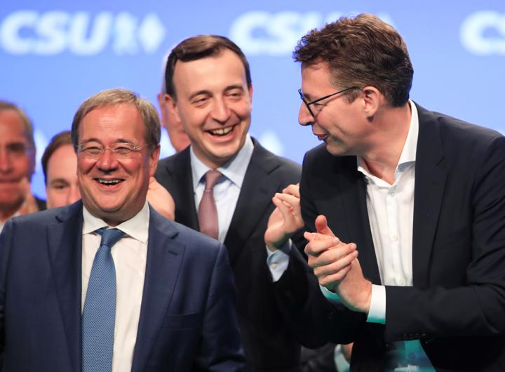 Armin Laschet, Christian Democratic Union of Germany (CDU) candidate for chancellor on stage with CDU secretary general Paul Ziemiak and Markus Blume, Secretary General of the CDU's Bavarian sister party Christian Social Union CSU following the CSU party meeting in Nuremberg, Germany, September 11, 2021. REUTERS/Wolfgang Rattay