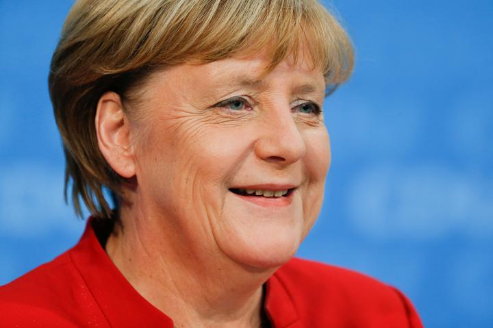 FILE PHOTO: German Chancellor Angela Merkel addresses a news conference, to announce that she will run again for the chancellorship in the next year general elections, at the Christian Democratic Union Party (CDU) headquarters in Berlin, Germany, November 20, 2016. REUTERS/Hannibal Hanschke T/File Photo