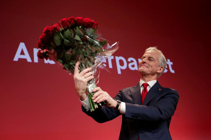 Norway's Labor Party leader Jonas Gahr Stoere holds a bouquet of red roses at the Labor Party's election vigil at the People's House during parliamentary elections in Oslo, Norway September 13, 2021. Javad Parsa/NTB via REUTERS