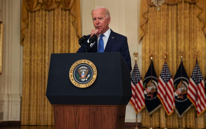 U.S. President Joe Biden clears his throat as he delivers remarks on the economy during a speech in the East Room of the White House in Washington, U.S., September 16, 2021. REUTERS/Leah Millis