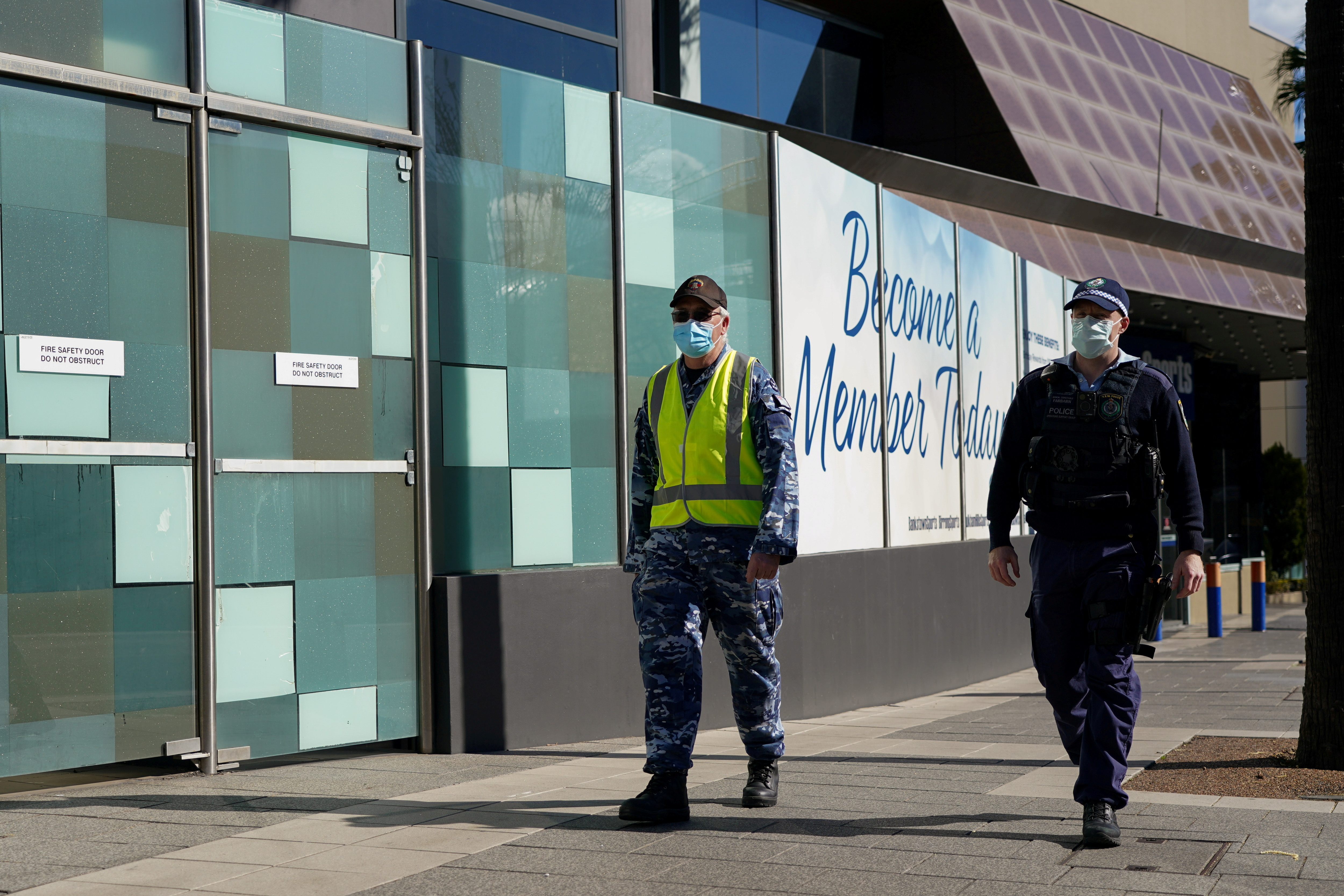 Australia reports 1,882 COVID-19 cases as police quell protests