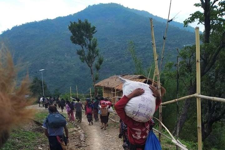 FILE PHOTO: People displaced by fighting in north-western Myanmar between junta forces and anti-junta fighters walk in Chin State, Myanmar, May 31, 2021. REUTERS/Stringer