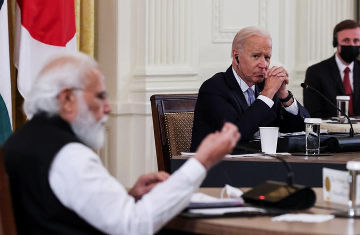U.S. President Joe Biden listens as India's Prime Minister Narendra Modi speaks during a 'Quad nations' meeting at the Leaders' Summit of the Quadrilateral Framework held in the East Room at the White House in Washington, U.S., September 24, 2021. REUTERS/Evelyn Hockstein