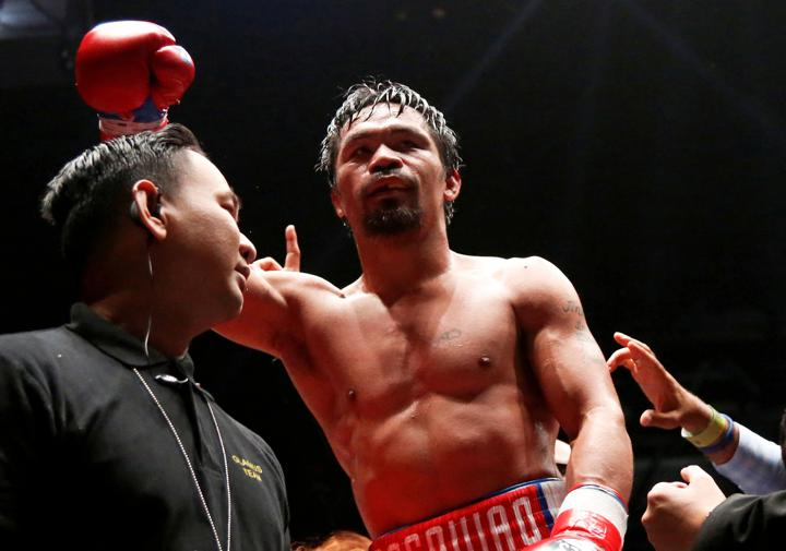 FILE PHOTO: Boxing - WBA Welterweight Title Fight - Manny Pacquiao v Lucas Matthysse - Axiata Arena, Kuala Lumpur, Malaysia - July 15, 2018 Manny Pacquiao celebrates after winning the bout against Lucas Matthysse. Picture taken July 15, 2018. REUTERS/Lai Seng Sin/File Photo