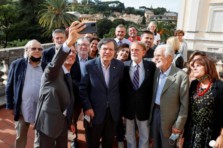 Joint winner of the Nobel Prize for Physics, Italian scientist Giorgio Parisi takes a selfie with his colleagues after the announcement in Rome, Italy, October 5, 2021. REUTERS/Remo Casilli