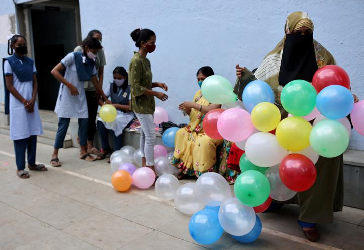 FILE PHOTO: Students and teachers prepare to decorate a school following the reopening after over a year due to the coronavirus disease (COVID-19) pandemic in Mumbai, India, October 4, 2021. REUTERS/Francis Mascarenhas/File Photo
