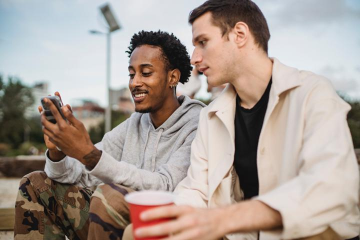 A happy employee refers his friend via text message