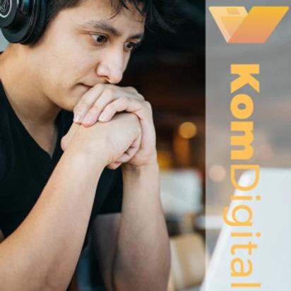 Person with headphones on thinking, KomDigital logo