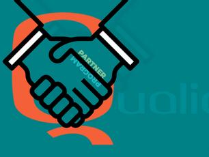 uQualio partner,  two hands doing a handshake.