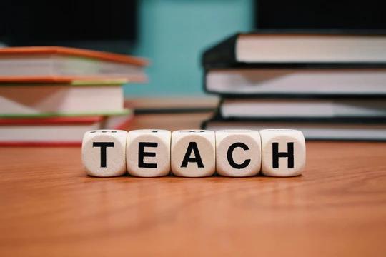 """Wooden blocks witj letters spelling """"Teach"""""""