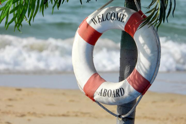 """Ring buoy hanging on tree, saying """"welcome aboard"""""""