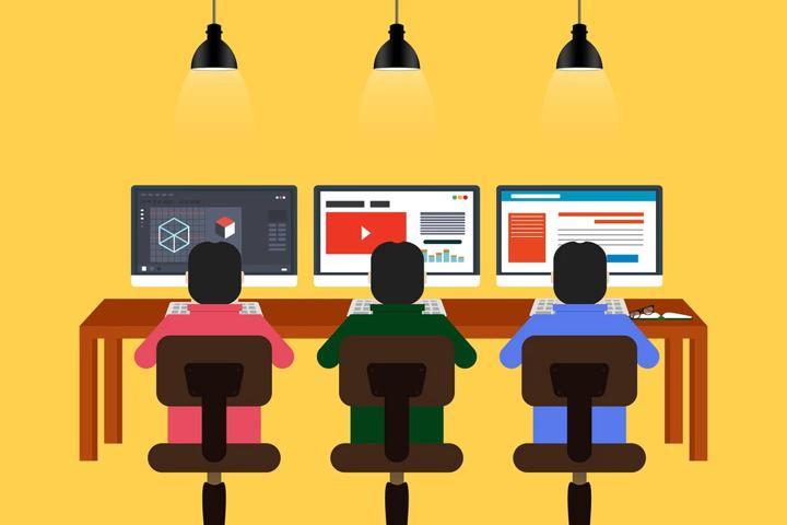 Three people on computers at desk cartoon
