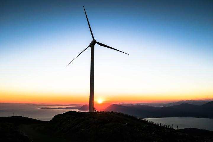 silhouette of wind mill during golden hour